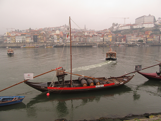 A view of Porto over the Douro from Vila Nova de Gaia and Taylor's rabelo. Photo: Jeff Love (cc-by)